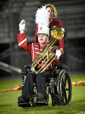 Ryan Montagna, pushed by his mother Ronnie, performs with the Annville-Cleona High School marching band at the 2016 Lebanon County Marching Band Exhibition held at Alumni Stadium in Lebanon in October. Montagna, who has cerebral palsy, plays he baritone.
