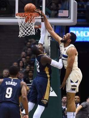 Jabari Parker of the Bucks dunks over Cheick Diallo of the Pelicans during the second quarter Sunday.