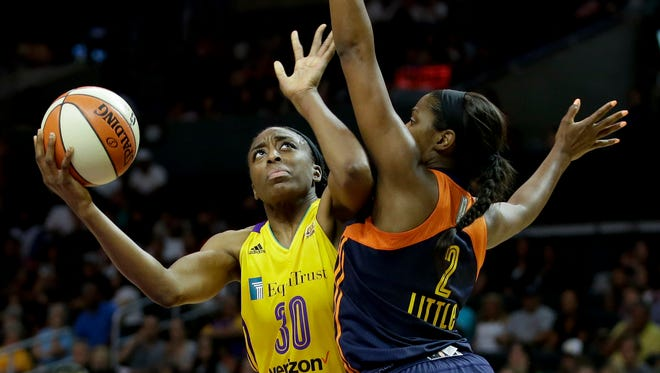 Los Angeles Sparks forward Nneka Ogwumike, left, shoots over Connecticut Sun forward Camille Little during the second half of an WNBA basketball game in Los Angeles.