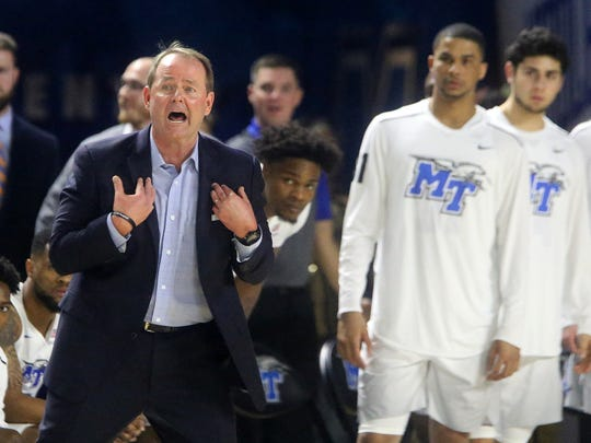 MTSU's Head Coach Kermit Davis as the referees what