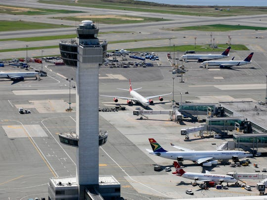 The air traffic control tower and terminals at John F. Kennedy International Airport are shown in an aerial photo, April 20, 2010 in New York.