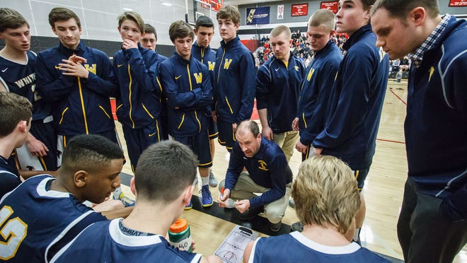 Whitnall head coach Steve Kujawa goes over strategy with his team during the regional final game at Pewaukee on Saturday, March 5, 2016.