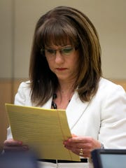 Defense attorney Jennifer Wilmott looks at her notes
