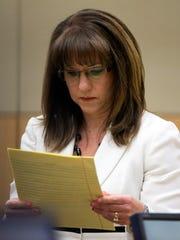 Defense attorney Jennifer Wilmott looks at her notes