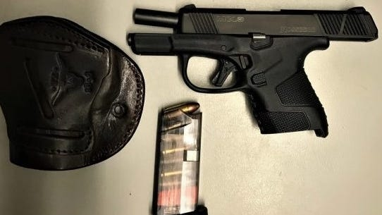 State police say they arrested two men, including one from Brockton, and seized a stolen loaded Mossberg 9mm pistol during a motor vehicle stop on Route 95 in Salisbury, Sunday, Oct. 25, 2020.