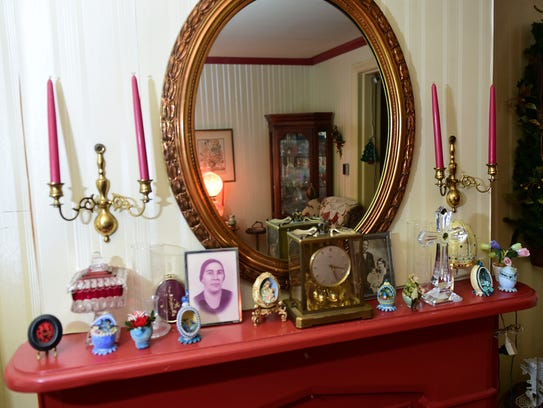 The mantle at Mildred Kelly's Chambersbrug home holds
