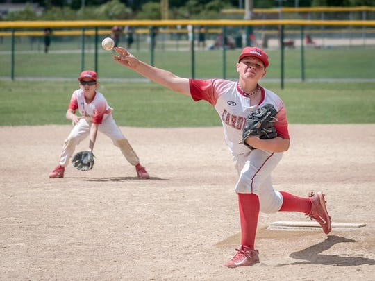 Delivering a pitch for the 11-Under Canton Cardinals during their state-title clinching win is Cal Rutherford.