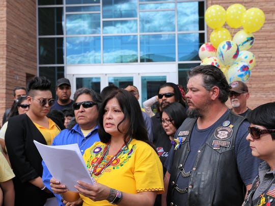 Mother of Ashlynne Mike Pamela Foster, center, speaks outside the Pete V. Domenici United States Courthouse in Albuquerque on Friday, Oct. 20, 2017, as Ashlynne's father Gary Mike, left, listens.