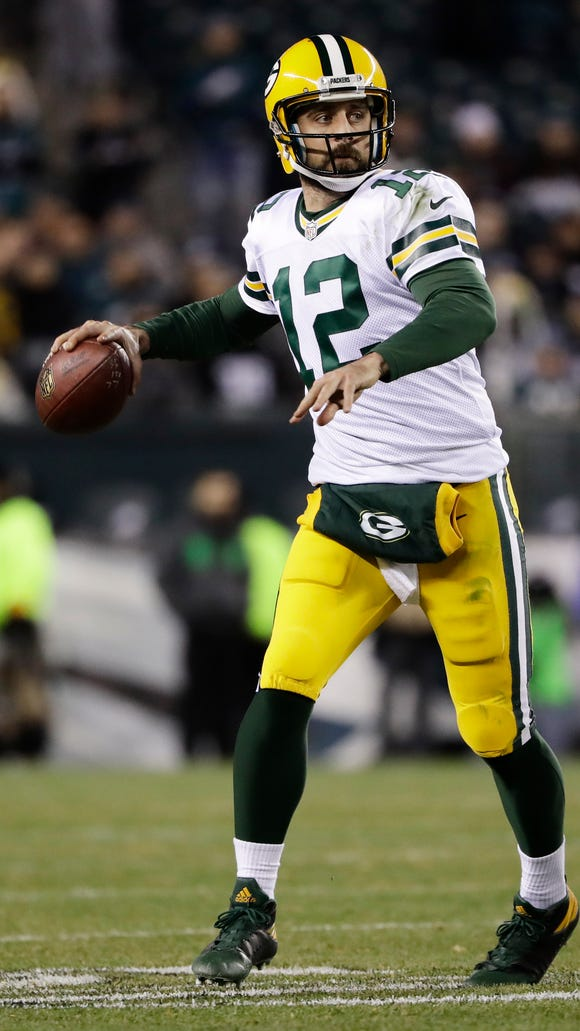 Green Bay Packers' Aaron Rodgers looks to throw against the Philadelphia Eagles during an NFL football game in Philadelphia on Nov. 28,