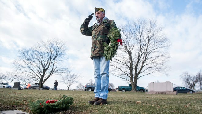 Army veteran Paul Prodehl salutes William D. Brown after laying down a wreath to honor him, Saturday, Dec. 16, 2017. This was the fifth year for Wreaths Across America at Mt. Olivet Cemetery, where over 1,700 veterans are honored.