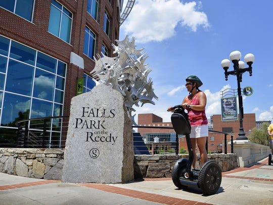 A Segway tour heads down Main Street in Greenville. The tours are among a number of new businesses built on Greenville's increase in tourism.
