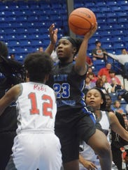 Red River's Oksonna Williams (23, right) shoots over