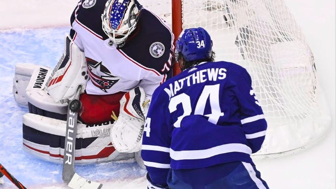 Joonas Korpisalo (70) stopped this shot by Maple Leafs star Auston Matthews (34) to keep it 0-0 in the second period and made 28 saves in a 2-0 shutout victory that put the Blue Jackets up 1-0 in a five-game series to open the playoffs.