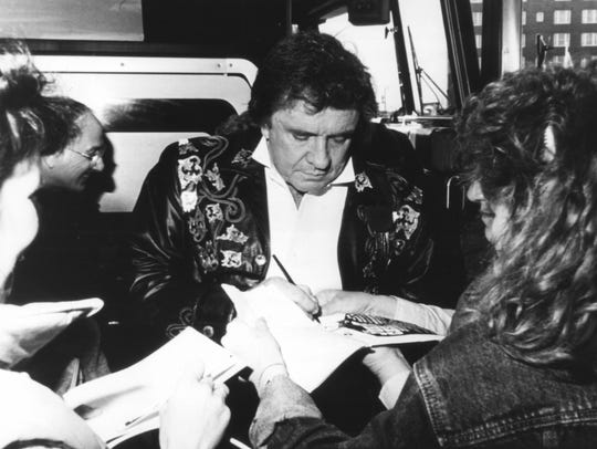 Johnny Cash signing autographs outside Asbury Park's
