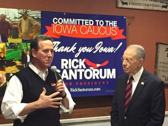 It wasn't an endorsement, but U.S. Sen. Chuck Grassley, R-Iowa, right, praised Republican presidential candidate Rick Santorum as a person of sound philosphy and a good family man during a campaign rally at a Pizza Ranch in Urbandale on Sunday night.