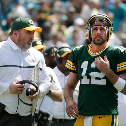 Green Bay Packers quarterback Aaron Rodgers (12) and