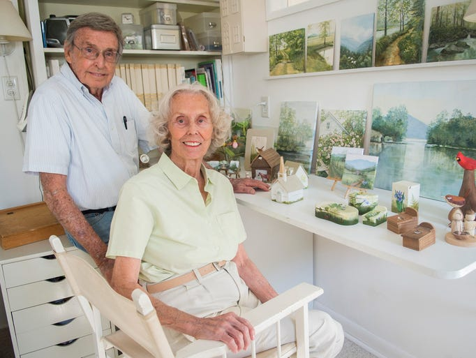 Hugh Webb and his wife, Barbara Webb, stand with pieces
