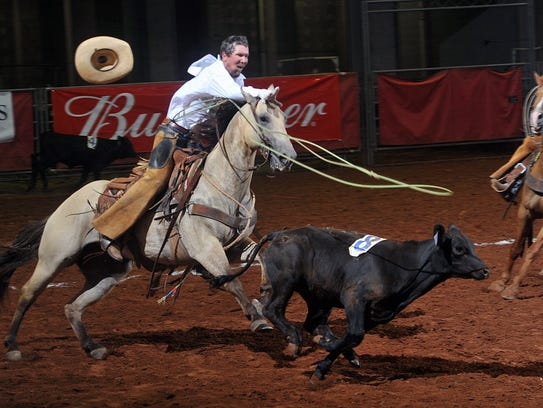 Chris Henry of the Waggoner Ranch lets his loop fly