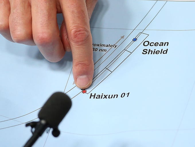 Australian Air Chief Marshal Angus Houston shows the current search areas of the ships Ocean Shield and Haixun 01. Houston confirmed that the Australian naval vessel Ocean Shield has twice detected signals in the past 24 hours consistent with aircraft black boxes.