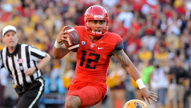 Arizona quarterback Anu Solomon (12) shook off an ankle injury to lift the Wildcats to the Pac-12 South title on Friday.