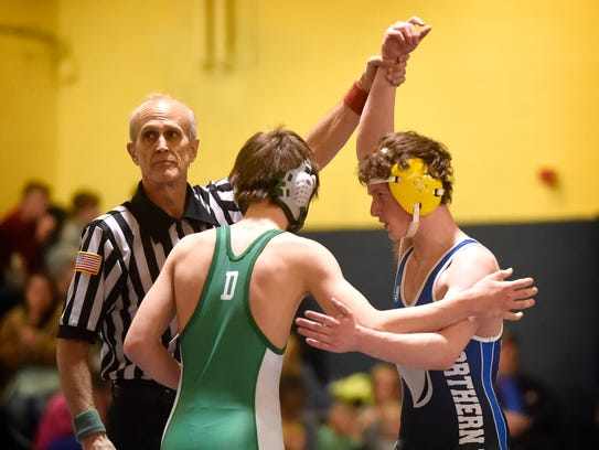 Northern Lebanon's Keaton Bender, right, takes the