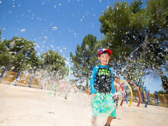 Ryan Campbell, 3, plays on the splash pad at Altadena