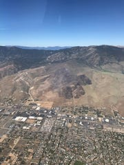 An aerial view of the Voltaire Fire burn scar above