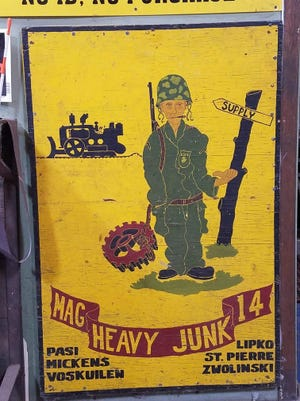John Zwolinski of Cudahy was the model for this plywood painting in 1954 when he and the other men listed on it served in the Marine Corps in North Carolina. Zwolinski sold the painting years ago and immediately regretted doing so. It was recently spotted at a scrap dealer's shop, where the owner doesn't want to part with it.