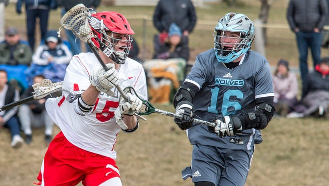 CVU's Sam Sturim gets by So Burlington's Pat O'Hara for a shot on goal during their game on Wednesday in Hinesburg.