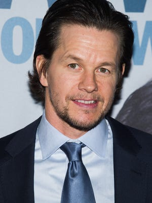 Mark Wahlberg's Beverly Hills mansion features a full outdoor basketball court, wine cellar, gym, library, and a rock-landscaped swimming pool with a waterfall and a diving rock, according to The Hollywood Reporter.
