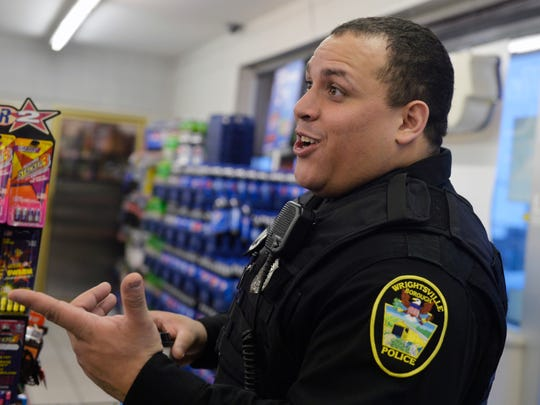 Wrightsville patrol officer Shawn Wilson shares a joke with Turkey Hill employees  in November. Wilson grew up in York where he remembers seeing his brothers get arrested. Today, he's a police officer and using his life experiences to interact with the community in positive ways.