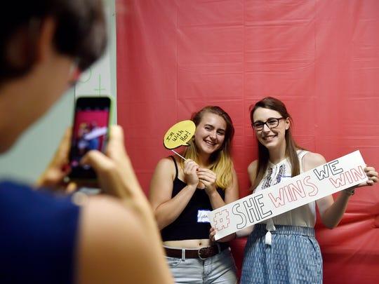 Madeleine Nesbitt of Spring Garden Township takes a photo of Lydia Paulos and Madison Strine, both of Spring Garden Township, during a York County Democrats delegate send-off party Saturday, July 23, 2016, at Hillary Clinton's campaign office in York. The Democratic National Convention opens in Philadelphia Monday, July 25.