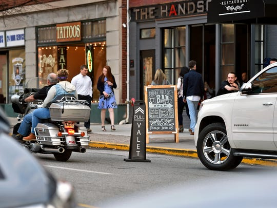"A sign out from the curb indicates Pullman Valet Service's presence Saturday, March 25, 2017, outside Tutoni's Restaurant on North George Street. Ryan Schriver, who began operating the valet service last November in response to York's perceived parking problem, has noted out-of-town visitors seem more comfortable than in-town diners with the concept of valet parking. ""We've got to train York a bit,"" Schriver said."