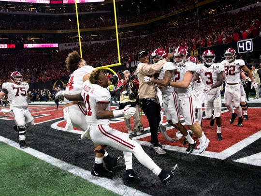 Alabama wide receiver DeVonta Smith (6) celebrates game winning touchdown during the NCAA National Championship football game between Alabama and Georgia on Monday, Jan. 8, 2018, in Atlanta, Ga.