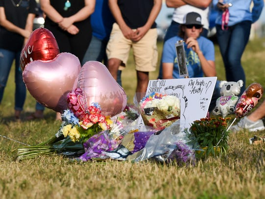 Friends and family gathered in the median of Okeechobee Road Wednesday, Feb. 7, 2018, to mourn the deaths of Santia Feketa, 18, and Britney Poindexter, 17, both of Fort Pierce, on Okeechobee Road just west of Midway Road in Fort Pierce. The two teenagers were killed Tuesday, Feb. 6, after their pickup was hit head-on by an RV driven by a 98-year-old Michigan man.
