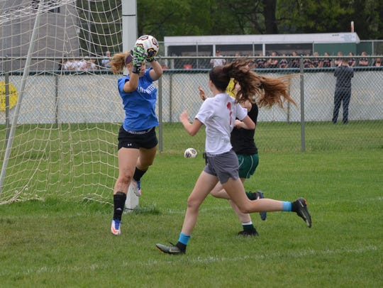 Pennfield senior goalie MeKenzie Lamb makes a save