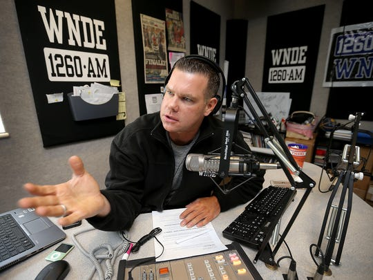 Jake Query talks to his co-host Derek Shultz,in different studio, on their sports radio show 1260am WNDE during the afternoon drive time from 3-7pm.