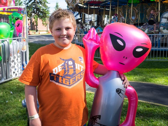 Ethan Rumple, 10, of Kimball, stands with an inflatable