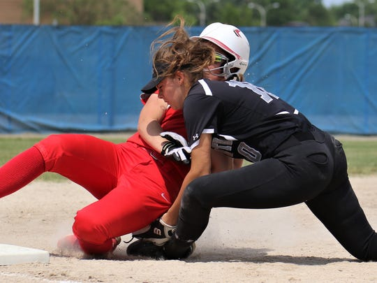 Plymouth sophomore third baseman Haley Gagnon (10) tags out Canton's Izzy Dawson in a crucial sixth-inning play Saturday.