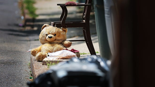 A stuffed animal takes the place of a chair leg on the curb near a large pile of household garbage on North Hollywood. Memphis Public Works could soon launch a citywide campaign against blight, targeting common violations like citizens leaving their garbage carts at the curb overnight.