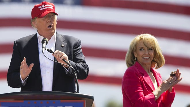 Former Arizona Gov. Jan Brewer applauds as Donald Trump speaks during a March 19 campaign rally in Fountain Hills.
