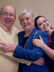 Peggy Gilmer, center, with her children, Chris (left) and Holly.
