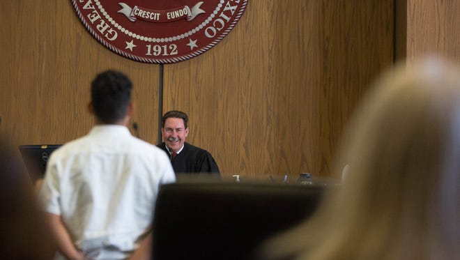 Chief Judge Jim Martin talks with one of the first clients in the inaugural Veterans Treatment Court on Wednesday May 23, 2018. This is a new diversion court for veterans charged with non violent felonies.