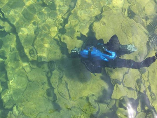 Almost 15 feet below the surface of Table Rock Lake, diver Andy Carpenter is still easily visible in water that