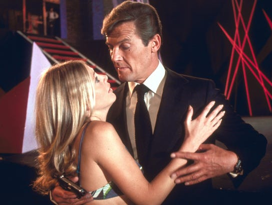 Britt Ekland (left) and Roger Moore share a moment