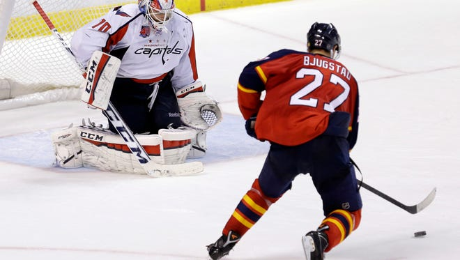 Florida Panthers center Nick Bjugstad prepares to score against Washington Capitals goalie Braden Holtby (70) in the 20th round of a shootout, the longest shootout in the history of an NHL hockey game, in Sunrise, Fla., on Tuesday, Dec. 16, 2014.