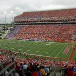 Fans pack Cardinal Stadium in Louisville, Ky., Sunday, Sept. 2, 2012, for the NCAA college football game season-opener for Kentucky and Louisville in Louisville, Ky., Sunday, Sept. 2, 2012. (AP Photo/Garry Jones)