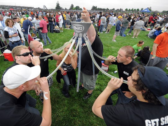 Fan execute a team beer bong during the 2011 edition of Carb Day.