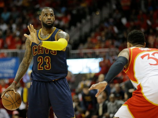 Cleveland Cavaliers forward LeBron James directs traffic