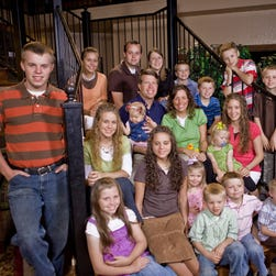 "The Duggar family in a 2009 promotional photo for ""19 and Counting."""